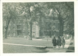 Women walking past Currier Hall, The University of Iowa, 1920s