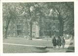 Women walking past Currier Hall, The University of Iowa, 1920s
