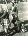 University of Iowa Scottish Highlanders dancers on sidelines of football game, 1969 or 1970