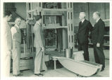 Officials viewing testing equipment in materials testing laboratory, The University of Iowa, 1937