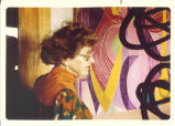 Drewelowe standing in front of one of her paintings, 1980s
