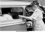 Ambulance with patient, The University of Iowa, July 12, 1948
