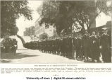 Commencement procession walking down Washington St. hill past Engineering Building, 1920s?
