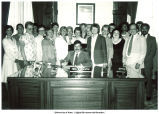 Gov. Terry Branstad signing Comparable Worth bill, with supporters looking on, Des Moines, Iowa, June 1983