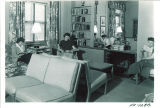 Women reading in Currier Hall's redecorated study area, The University of Iowa, November 28, 1949