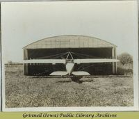 Rear view of plane entering hangar<br />