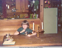 John, Jr. sitting at table