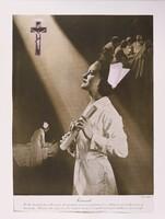 Nurse looking at cross