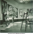 Students painting modern art mural, The University of Iowa, March 1940