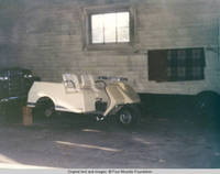 Golf cart inside barn