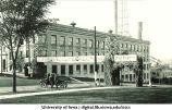 Alumni sign near Engineering building, Homecoming, The University of Iowa, 1920s