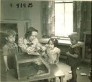 Children and teacher with pet rodent, The University of Iowa, January 12, 1938