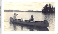 Frindy and Vidie Burden in Canoe with Denise, the dog