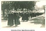 University of Iowa President Thomas Macbride, left, leading commencement procession west down Washington St., The University of Iowa, June 1916