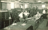 Men with typesetting machines in Close Hall, The University of Iowa, 1920s