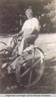 John Heitzman on a hay mower