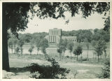 Theatre Building seen through trees across Iowa River, The University of Iowa, July 28, 1936