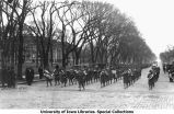 Military band marching south on Clinton Street, The University of Iowa, 1918