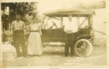 Men and woman posed in front of car, Lamont, Iowa, 1910s