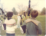 Scottish Highlanders field practice led by drum major Mark Isaacs, The University of Iowa, October 1980