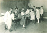 School children around table in Miss Watkins' room, The University of Iowa elementary school, October 1921