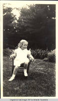 Vidie Burden sitting in chair in garden