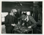 Two cadettes welding metal parts together, 1943