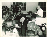 University orchestra rehearsing in Old Music Building, The University of Iowa, 1940s