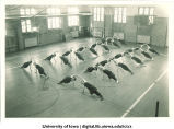 Students in gymnasium doing calisthenics, The University of Iowa, 1930