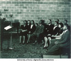 Speaker addressing African American audience at WSUI, The University of Iowa, 1940s