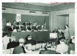 Louise Noun, George Gallup, Mr. Groner, Mrs. Roach, Mr. Webster, Mr. Myers, Mr. Ebeling, Mr. Perlis, Mr. Hale and Dean Bradshaw participating in the All-America Cities jury hearings, 1954