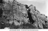 """East wall of """"The Mound"""", north of Luverne, Minn., late 1890s or early 1900s"""