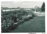Flowers and pedestrian bridge on west side of Iowa Memorial Union, the University of Iowa, 1930s?