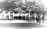 Students crossing Pentacrest, The University of Iowa, 1920s