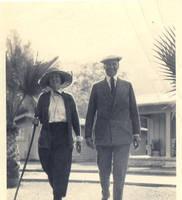 Aunt Van and Uncle Maurice walking near palm trees