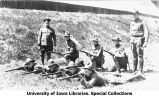 Rifle team and captain near Armory, The University of Iowa, 1918