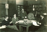 Men studying large fossils, The University of Iowa, 1920s