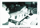 Students playing Monopoly and drinking Cokes, The University of Iowa, January 1964