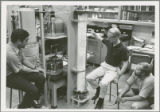 Thomas D. Wheelock and researchers study apparatus.