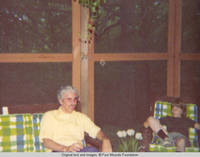 Bill and John, Jr. sitting in the screened in porch