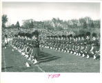 Scottish Highlanders performing at athletic field, The University of Iowa, 1950s?