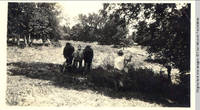 John Heitzman on haycutter with two men working