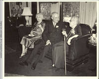 Cornelia, Bill and Viola sitting on couch in living room