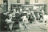 School children playing or working on projects, The University of Iowa, April 22, 1927