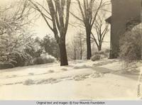 Grey house carport in winter