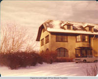 View of car parked in front of Grey house in Winter