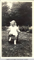 Vidie Burden sitting in chair in garden looking down