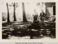 Arlene mowing lawn with John