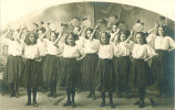 Girls dancing with tambourines on their heads, Roland, Iowa, 1910s
