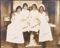 Four nursing students rom the class of 1928 pose for picture